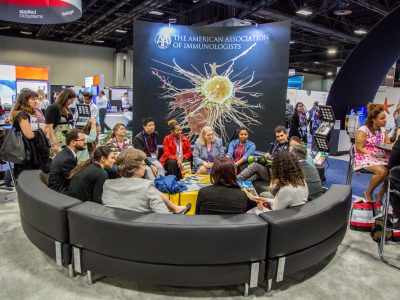 AAI Public Policy Fellows gathered at the AAI Booth